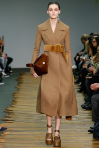 Celine- Beautiful fitted trench coats showcasing large waist belts and hand bags.
